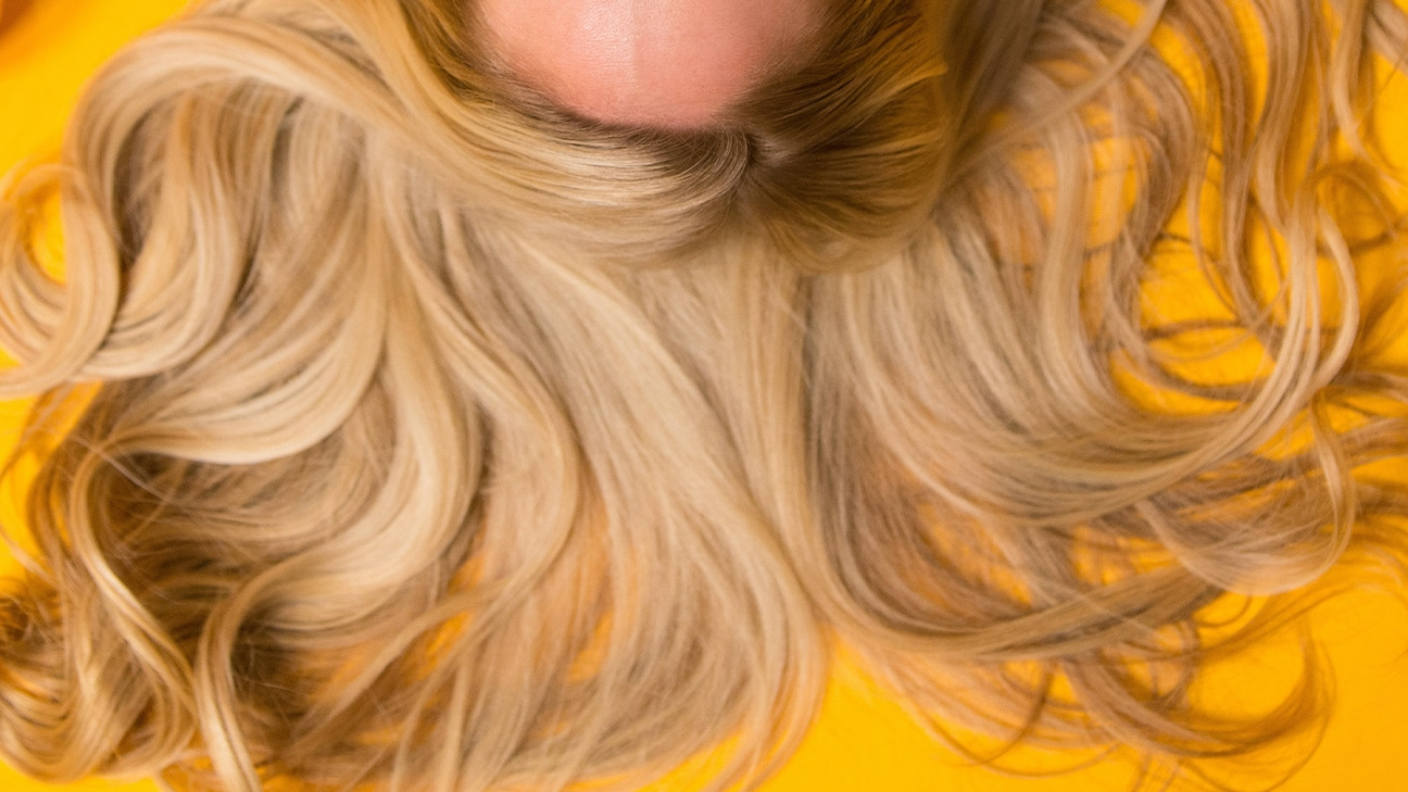 woman long hair lying on ground